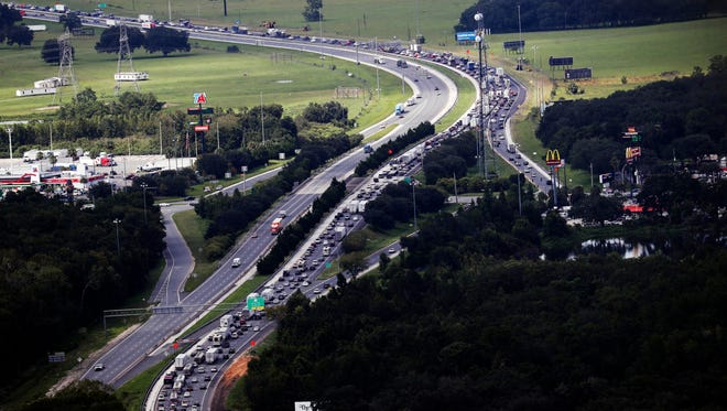 Florida residents flee Hurricane Irma as traffic backs up on I-75 at its intersection with the Florida Turnpike.