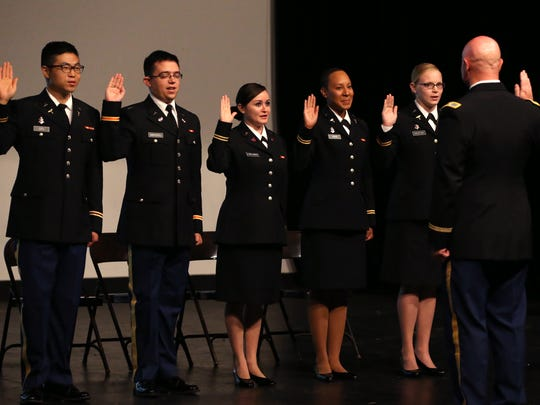 Ret. Col Matt Elledge gives the oath of office to 2nd Lt. Junsung Cho (from left), 2nd Lt. Kristopher Marrou, 2nd Lt. Stephanie Parlamas, 2nd Lt. George Ann B. Voss and 2nd Lt. Stephanie Shutak during the Texas A&M University-Corpus Christi Islander Army ROTC Commissioning Ceremony on Friday, Aug. 4, 2017. The ceremony marks the transition of graduating ROTC students from cadets to enlisted officers.