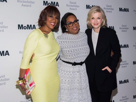 Gayle King, left, Oprah Winfrey and Diane Sawyer attend