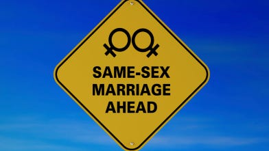 Same-sex marriages ahead road sign