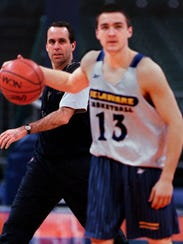Mike Brey looks on during his Delaware coaching days.