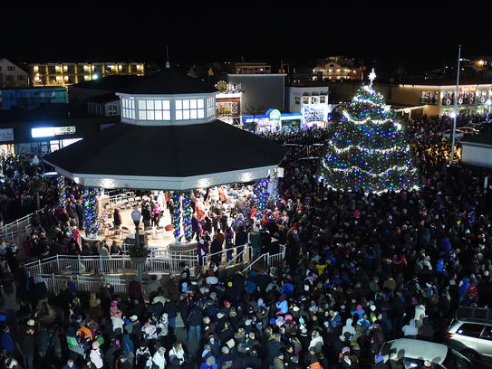 In this file photo, the tree is seen from the top of Thrasher's French Fries. More than 4,000 people were on hand for Rehoboth Beach's annual Christmas tree lighting in 2014.