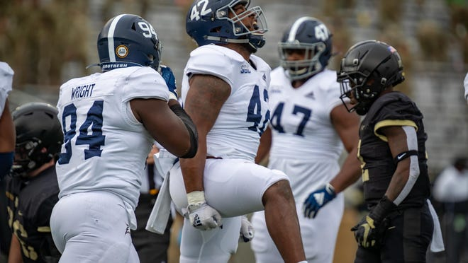 Georgia Southern defensive end Dillon Springer (42) celebrates a play against Army at Michie Stadium on Nov. 21, 2020 in West Point, New York.