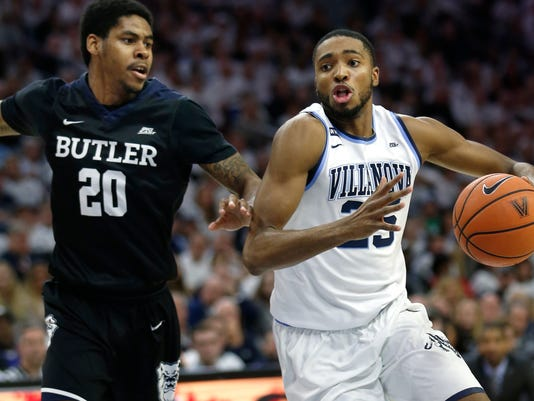 Villanova guard Mikal Bridges (25) moves around Butler guard Henry Baddley (20) during the second half of an NCAA college basketball game, Saturday, Feb. 10, 2018, in Philadelphia. Villanova won 86-75. (AP Photo/Laurence Kesterson)