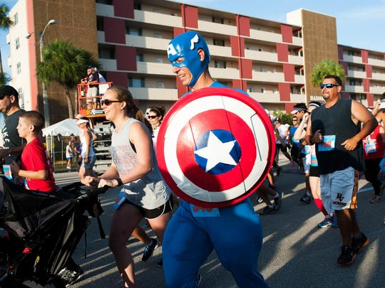 Nathan Veilleux, dressed as Captain America, runs in the Freedom 5k in Cape Coral on Saturday, July 4, 2015.