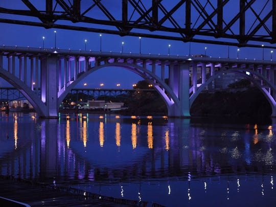Henley Street Bridge stands lit up in purple as a tribute to Prince on Friday, April 22, 2016. (CAITIE MCMEKIN/NEWS SENTINEL)