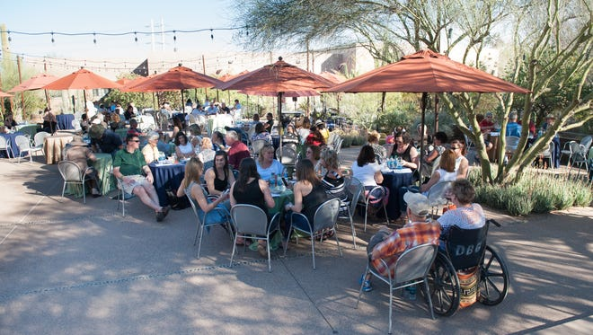 The patio fills with wine lovers during Corks & Cactus at the Desert Botanical Gardens in Phoenix on Saturday, Feb. 20, 2016.