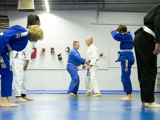 Sue Carter guides her blind husband, David Carter, during a gentle jiu-jitsu class Saturday, Dec. 16, 2017 at Gracie Barra Las Cruces Brazilian Jiu-Jitsu and Self-Defense.