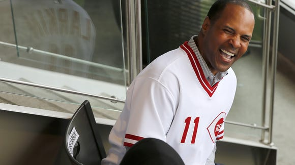 Former Reds shortstop and Hall of Famer Barry Larkin shares a laugh with  former teammate Eric Davis during pre-game ceremonies to honor the 1990 Reds on April 25.