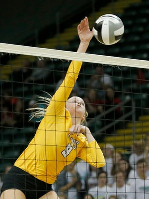 Ursuline senior Ali Thompson (9) leaps to shoot in the fourth set of the the Division I State Championship Semi-Final match between No. 4 Dublin Coffman  vs. No. 1 Cincinnati Ursuline Academy at the EJ Nutter Center in Fairborn, Ohio, on Thursday, Nov. 9, 2017. Ursuline forced a fifth set with a 25-21 win in the set four.