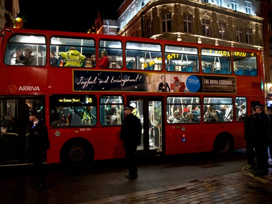 Shocked and injured theatergoers are transported to hospital in a commandeered London bus  following an incident  during a performance at the Apollo Theatre.