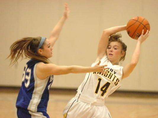 Eastern York girls' basketball player Abby Brate, pictured here last season against Hempfield, has helped the Golden Knights to a 2-1 record in Division III.
