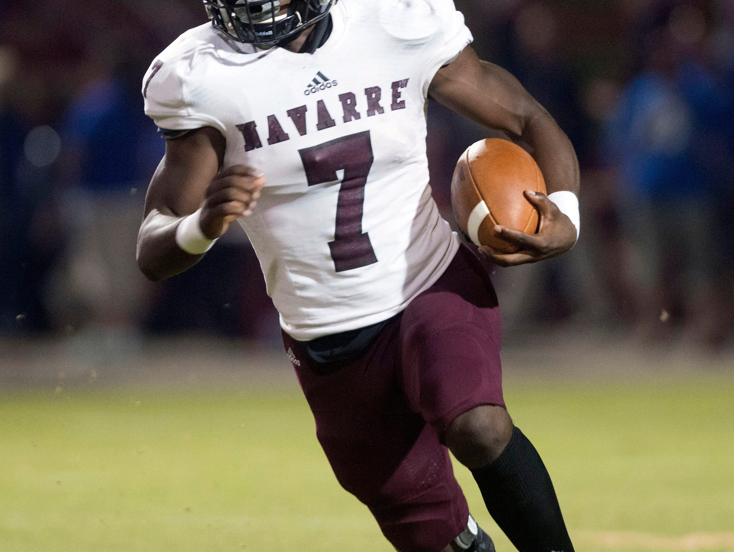 Navarre High School star running back Michael Carter, (No. 7) looks for running room against the Pace High School defense during Friday night's District 2-6A matchup.
