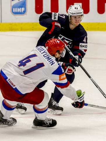 Russia's Nikolai Kulyomin defends against the USA's