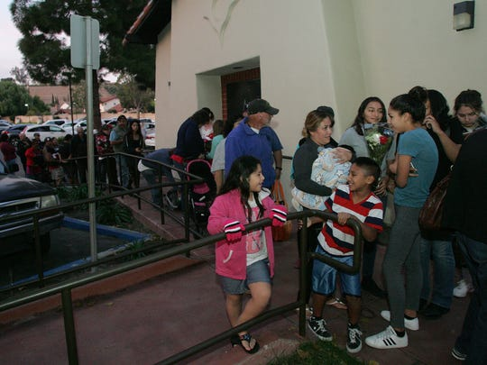 A crowd waits in line to enter for a meal and visit