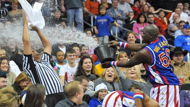 Big Easy Lofton doing the traditional water bucket skit of the Harlem Globetrotters.