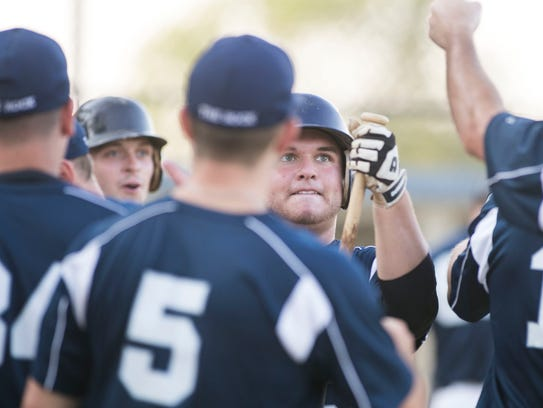 Glen Rock's Luke Knott, fist pumps with a teammate,