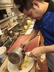 Clydz Executive Chef Orlando Ramos plates rabbit rattlesnake