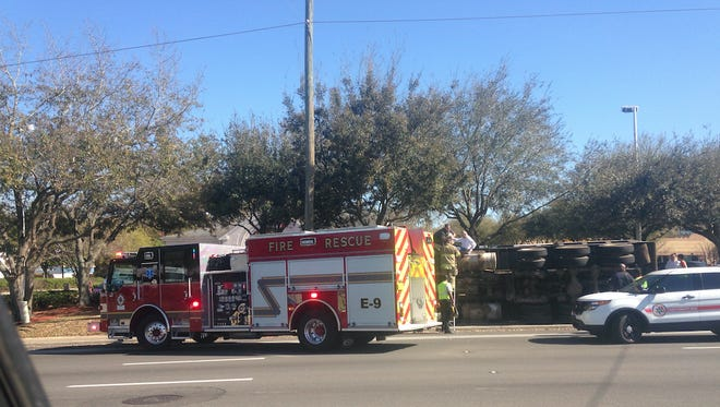 An overturned dump truck at Thomasville Road and Village Square Boulevard has blocked one lane of traffic.