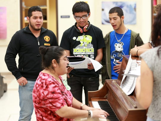 Brian Gomez, left, Christian Mendez, center, and Julian Gonzalez rehearse with teacher Roxanne Rios on Thursday in the Bowie choir room.
