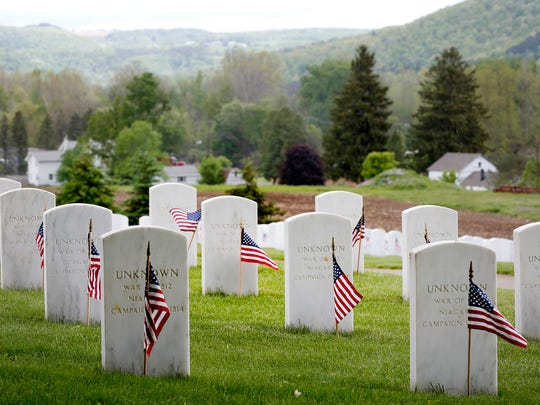 Graves of unknown War of 1812 soldiers reside on the outskirts of the Bath National Cemetery on May 26.