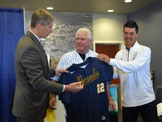 Nevada athletic director Doug Knuth, left, and Nevada