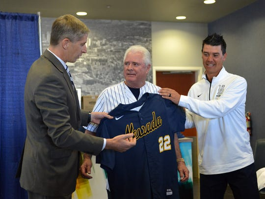Nevada athletic director Doug Knuth, left, and Nevada baseball head coach T.J Bruce, right, present Nevada alum Don Weir, center, a baseball jersey after Friday's announcement.