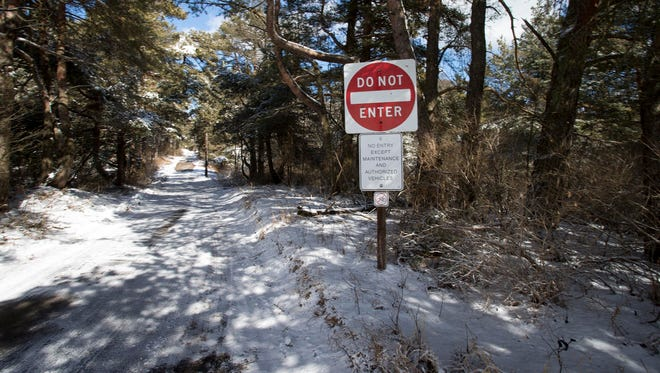 A sign leading to the shop area at Kohler-Andrae State Park as seen, Wednesday, March 7, 2016, in Sheboygan, Wis. Kohler plans to build a maintenance facility near the park's building for its proposed golf course.