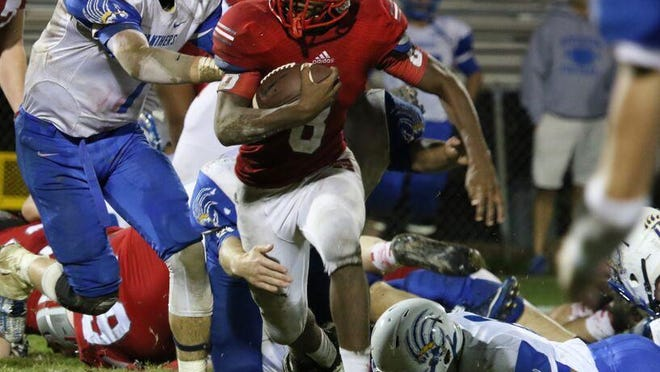 McKenzie's Eric Robinson looks for running room in Friday's first round playoff game vs. Riverside.