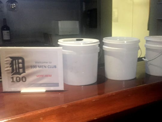 Keith Charron of 100 Men Club in metro Detroit said the group drops stones into white buckets to decide which charity will receive its quarterly donation. The buckets are set up during their meeting on Thursday, June 8, 2017 in Royal Oak.