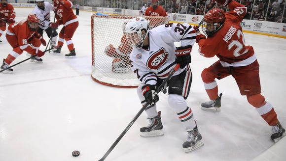 St. Cloud State?s Joe Rehkamp takes the puck behind