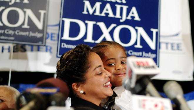 Maija Dixon and son after 2006 election to City Court