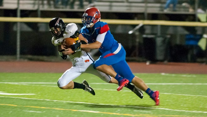 #21 #1Marine City's William Patsalis is brought down by St. Clair's Benjamin Davidson during their game Sept. 29.