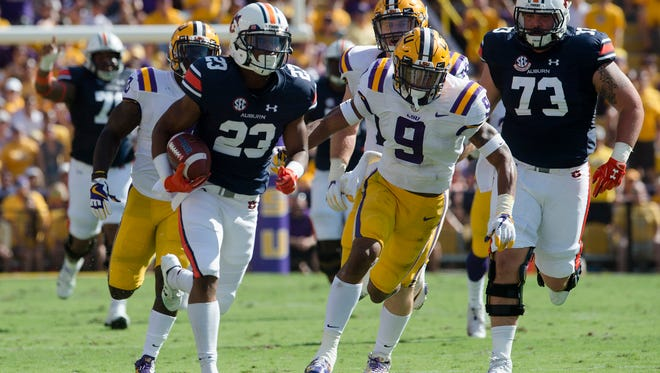 Auburn wide receiver Ryan Davis (23) runs downfield as LSU safety Grant Delpit (9) chases during the NCAA football game between Auburn and LSU on Saturday, Oct. 14, 2017, at Tiger Stadium in Baton Rouge, La.