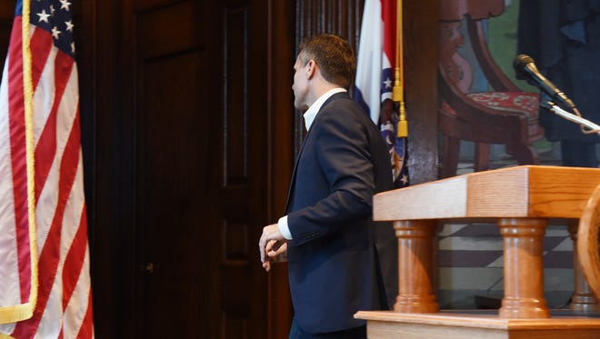 Missouri Gov. Eric Greitens leaves the podium after announcing his resignation at a news conference, Tuesday, May 29, 2018, at the state Capitol, in Jefferson City, Mo. Greitens resigned amid a widening investigation that arose from an affair with his former hairdresser. Greitens said his resignation would take effect Friday.