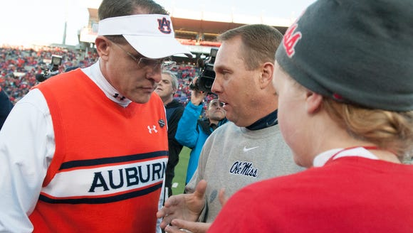 Auburn head coach Gus Malzahn greets Mississippi head