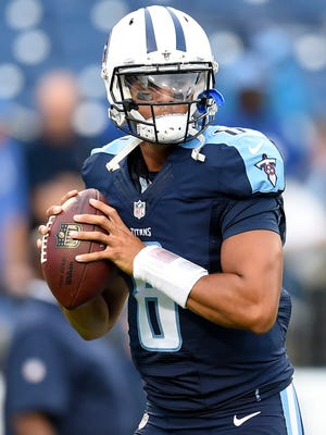 Titans quarterback Marcus Mariota (8) warms up before the start of the team's preseason opener against the Chargers at Nissan Stadium Saturday, Aug. 13, 2016 in Nashville, Tenn.