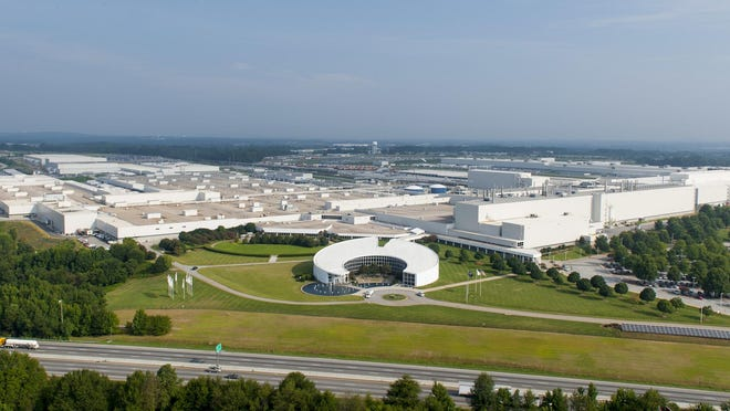 BMW Manufacturing Co. said Tuesday it agreed to pay $1.6 million and offer jobs to dozens of African-American applicants to resolve a federal lawsuit and charges based on the company's previous guidelines governing the use of criminal background checks at its plant in Greer.