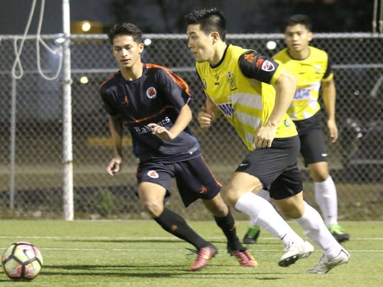 In this file photo, the NAPA Rovers' Min Sung Choi looks for options near the goal as Islas de los Ladrones FC's Seth Surber tracks him on defense in a Budweiser Soccer League match at the Guam Football Association National Training Center.