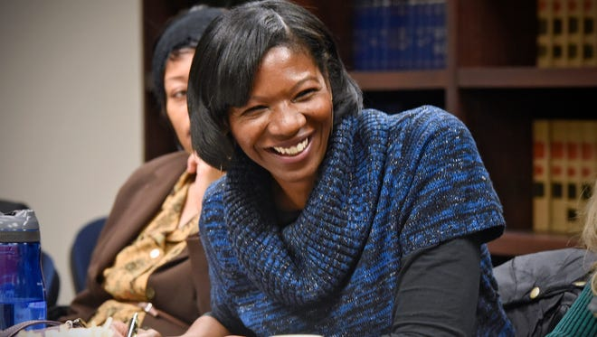 """Cynthia """"CeCe"""" Turlouw smiles when meeting with officials Friday, Dec. 16, at the Stearns County Attorney's Office in St. Cloud. Turlouw is working to open Terebinth Refuge, a non-profit shelter that provides services to adults who have been sexually exploited."""