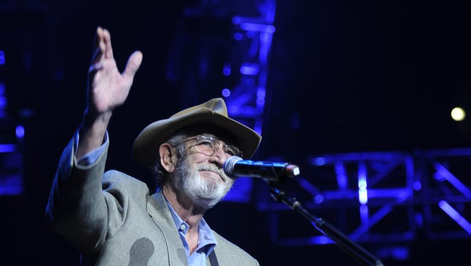Don Williams waves to the crowd after performing at the We're All for the Hall Concert benefiting the Country Music Hall of Fame and Museum at the Bridgestone Arena Tuesday, April 10, 2012 in Nashville, Tenn.
