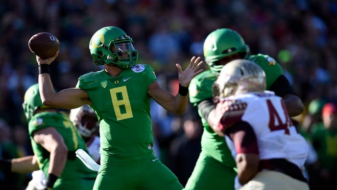 Jan 1, 2015; Pasadena, CA, USA; Oregon Ducks quarterback Marcus Mariota (8) drops back to pass against the Florida State Seminoles during the first half in the 2015 Rose Bowl college football game at Rose Bowl. Mandatory Credit: Kelvin Kuo-USA TODAY Sports