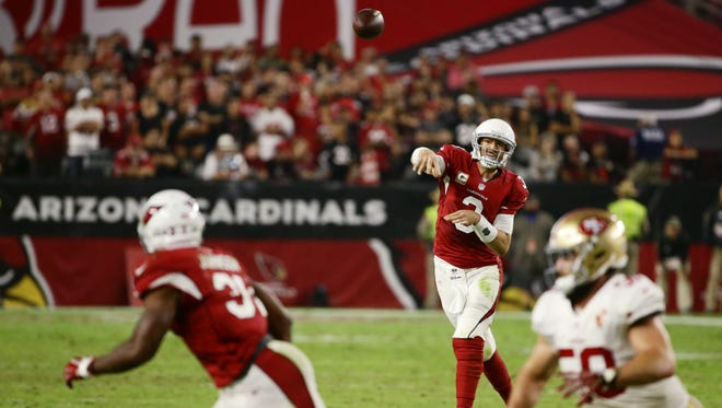 Arizona Cardinals' Carson Palmer throws and completes a pass to David Johnson against the San Francisco 49ers in the 4th quarter on Nov. 13, 2016 in Glendale, Ariz.