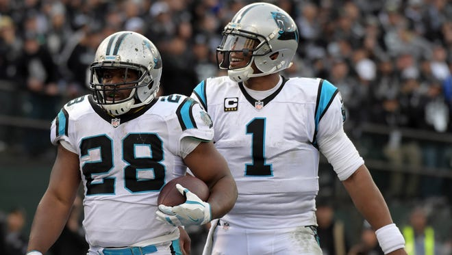 Panthers running back Jonathan Stewart, left, and quarterback Cam Newton will take aim at the Seattle Seahawks on Sunday night.
