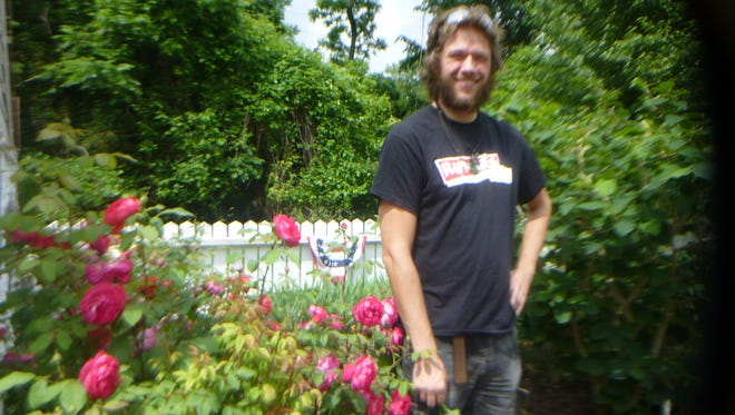 Martin Zorde inside of the Colonial Herbal Medicinal Garden.