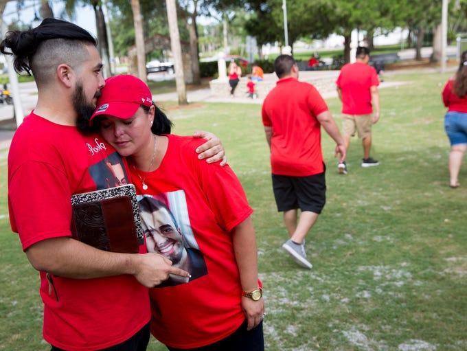 Johnathan Valero, a cousin of Jordan Valero, comforts