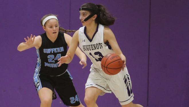 New Rochelle's Nicole Ziogas dribbles around Suffern's Caleigh Cahoon during their game at New Rochelle High School, Jan. 29, 2016. New Rochelle beat Suffern, 46-42.