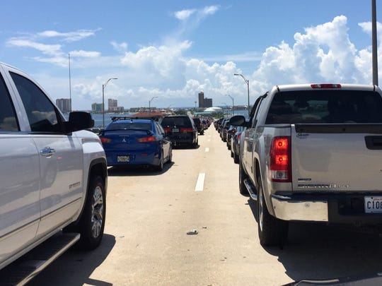 Traffic to Pensacola Beach isn't too bad at 12 noon... Cars are only backed up halfway on the bridge