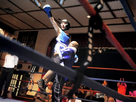 Trainer Julio Alvarez lifted up Benjamin Carter in celebration and defeating  an opponent during a York event in 2012. Alvarez has trained and mentored countless young people through his gyms in Hanover and York over the past three decades.