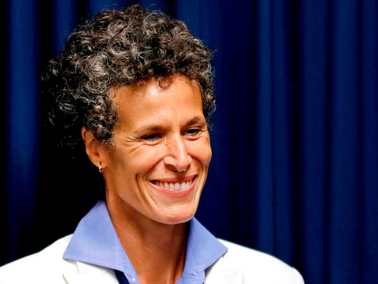 Bill Cosby accuser Andrea Constand smiles as she listens